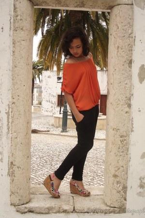 orange Zara shirt