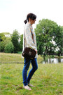 Light-blue-blouse-blue-jeans-dark-brown-bag