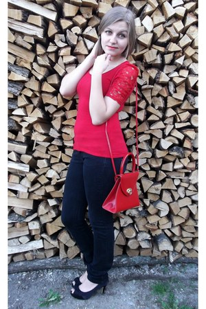 red top - ruby red bag - black heels - dark gray pants
