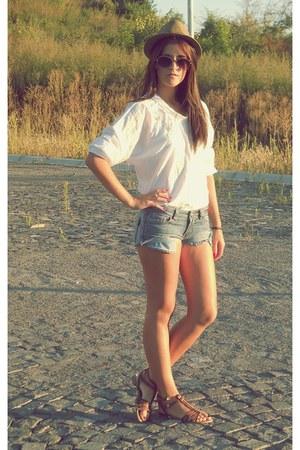 white shirt - dark khaki hat - sky blue shorts - brown sandals