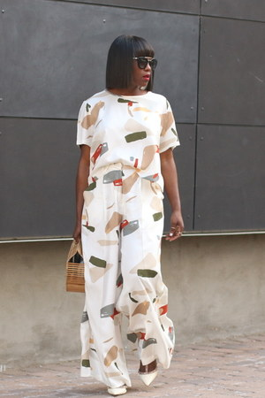 Abstract print pants - Bamboo bag - Black Sunglasses sunglasses - studded heels
