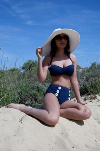 white hat - blue swimwear