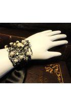 black RawwrKat bracelet
