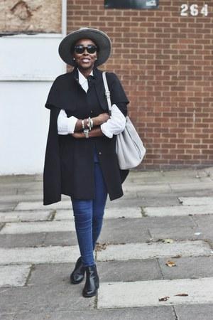 black H&M cape - black chelsea boots Deichmann boots - navy skinny asos jeans
