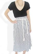 white STYLESOFIACOM skirt