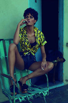 yellow neon shirt - black leather shorts - wood sandals - black bra