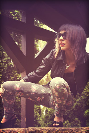 cropped leather jacket - floral print Billabong jeans - cat eye sunglasses