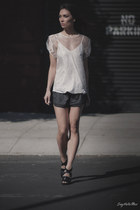 white tildon top - black adidas by stella mccartney shorts