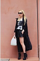 black shoes - black coat - white Furla bag - black shorts