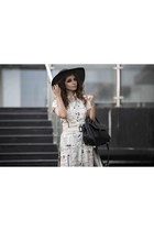black boonie hat Aldo hat - off white Shruti S shirt - black leather Zara bag