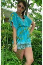 blue shirt - green shorts - beige sunglasses - silver accessories