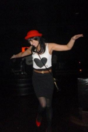 red thrifted hat - black skirt - white H&M vest