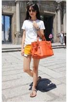 carrot orange Salvatore Ferragamo bag - white Gap shirt