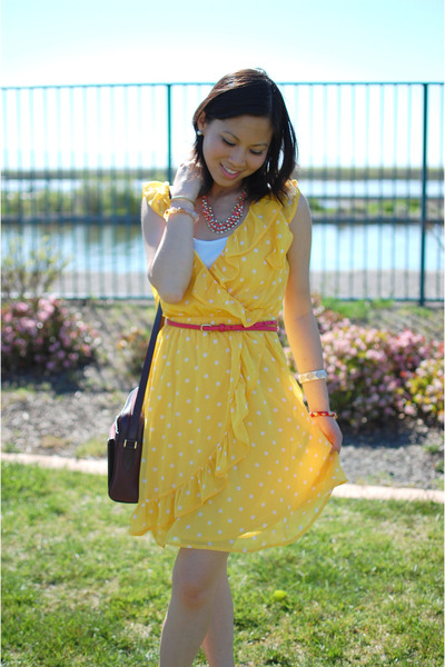 Yellow dress with red polka dots.