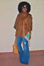 Tawny-leather-cape-blue-bell-bottom-jeans-aquamarine-color-block-top