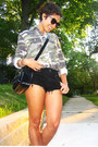 Army-green-uo-shirt-black-dr-martens-bag-black-american-eagle-shorts