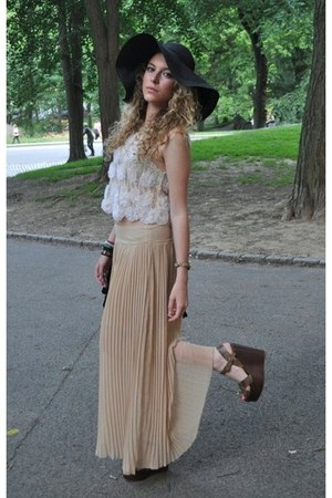 black black sunhat hat - nude pleated skirt - beige top - brown tan wedges