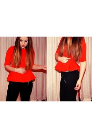 red top - black pants