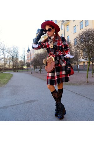 black boots - black thrifted coat - red bag