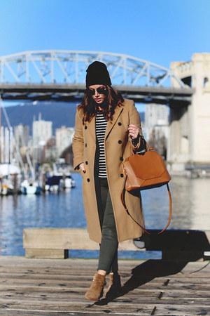 tan camel Aritzia coat - army green skinny jeans Mavi jeans
