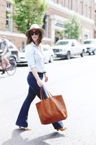 navy flare Mavi jeans - tan wool Express hat - brown leather madewell bag