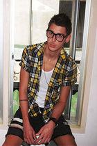 black glasses - gold shirt - black shirt - silver shirt - black shorts - white v