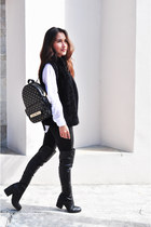 black leather Steve Madden boots - black backpack Michael Kors bag