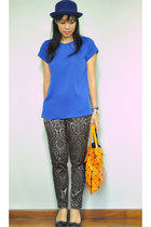 blue studded collar top - carrot orange Issey Miyake bag