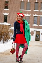 red apple hat - green wool coat - navy cashmere sweater - red tartan tights