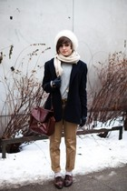 white hat - white scarf - black coat - gray sweater - beige pants - brown purse