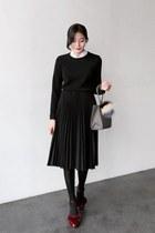black UPTOWNHOLIC skirt