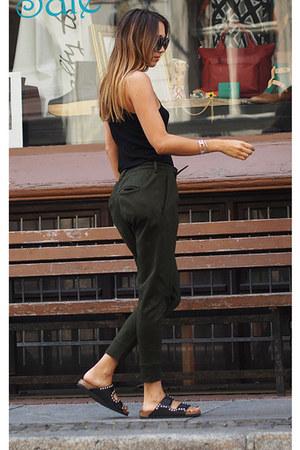 black Prada sunglasses - black cotton Zara top - dark green Drykorn pants