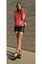 leather Reformation shorts - acne top - zora Isabel Marant wedges