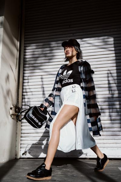 silver raincoat Zara coat - black snapback Zara hat - black sling Adidas bag