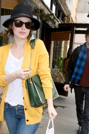 black hat - yellow cardigan - green purse