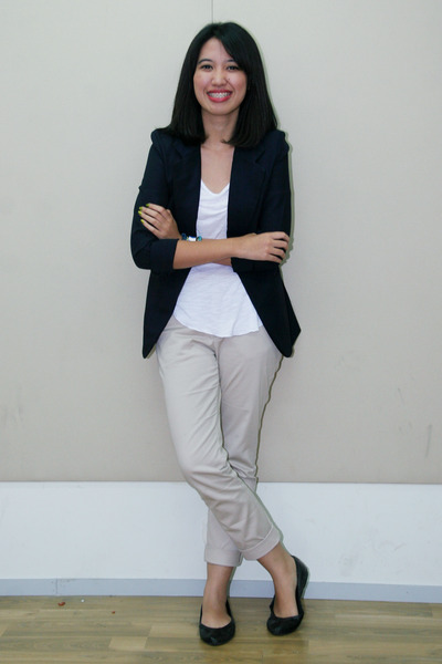 Model Example Pair A Black Blouse With Slim Leg Khakis And Black And White