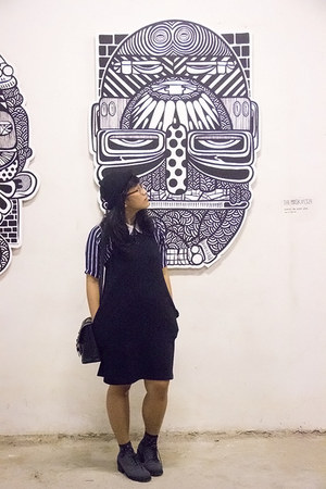 black overall dress - charcoal gray ankle MKS boots - black kitty hat