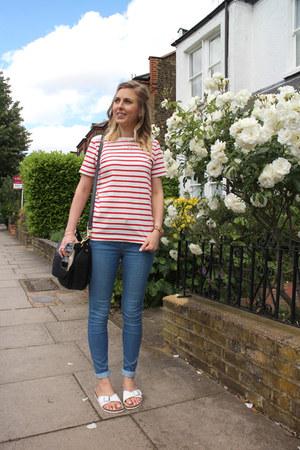 slider Birkenstock sandals - skinny Topshop jeans - stripe jaeger t-shirt