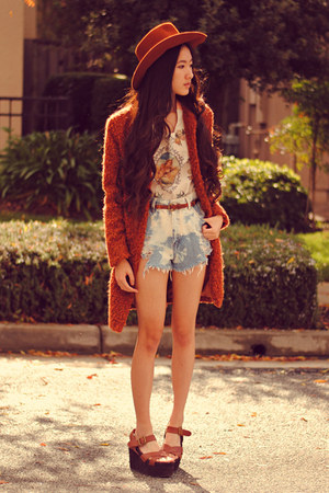 fuzzy Wasteland coat - Paradox shorts - flower child o-mighty top