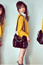 Black-bag-light-blue-shorts-white-top-mustard-cardigan