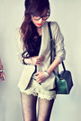 Tan-blazer-black-shirt-dark-green-bag-red-accessories-off-white-pants