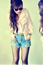 Sky-blue-shorts-neutral-blouse-mustard-belt