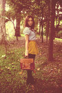 Mustard-skirt-light-blue-shirt-brown-bag
