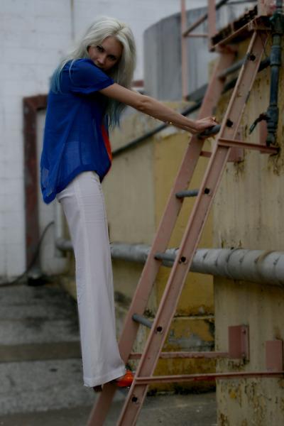 blue sheer Sugarlips top - white trousers BCBG pants