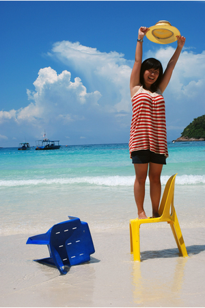 blue sky with yellow blue chair
