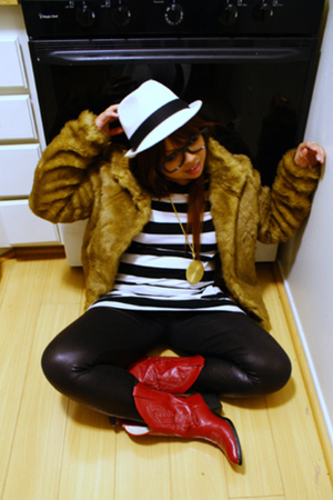 red boots - brown coat - black pants - gold accessories