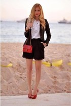 red bag - black shorts - white top