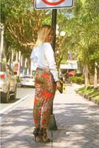 carrot orange pants - black bag - black heels - white top