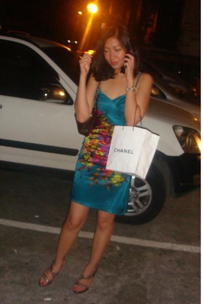 Mango dress - Chanel purse - Rolex - Oscar de la Renta