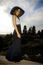 Black-thrifted-skirt-white-t-by-alexander-wang-t-shirt-black-billabong-hat-